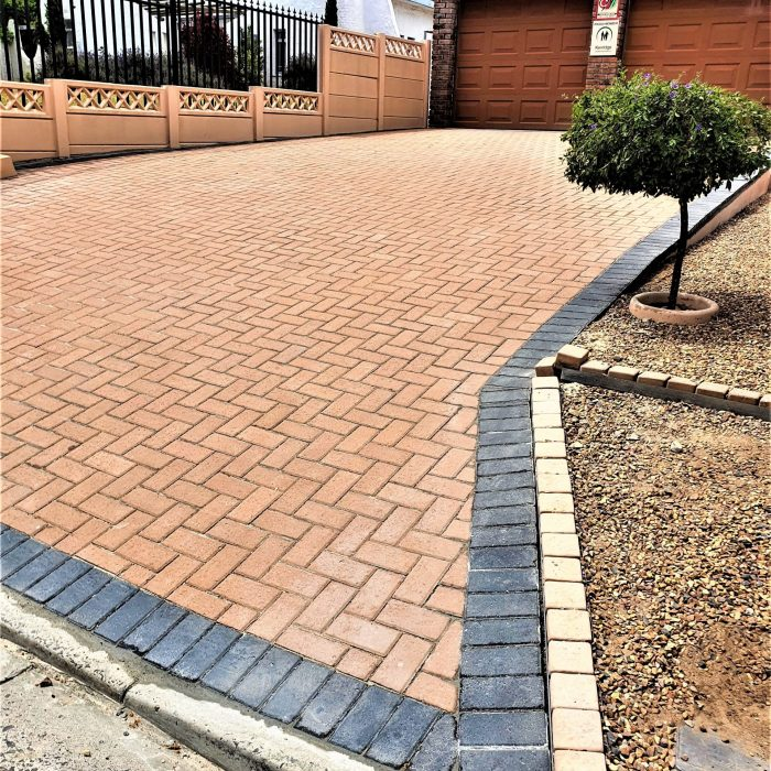 CEMENT BOND DRIVEWAY WITH CHARCOAL BORDER