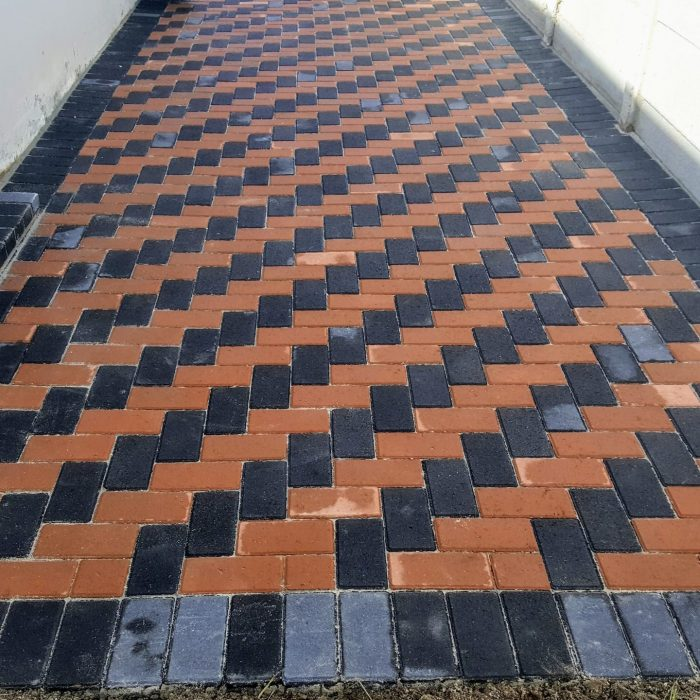 CEMENT BOND PAVERS WITH RED _ CHARCOAL 90 DEGREE HERRINGBONE PATTERN