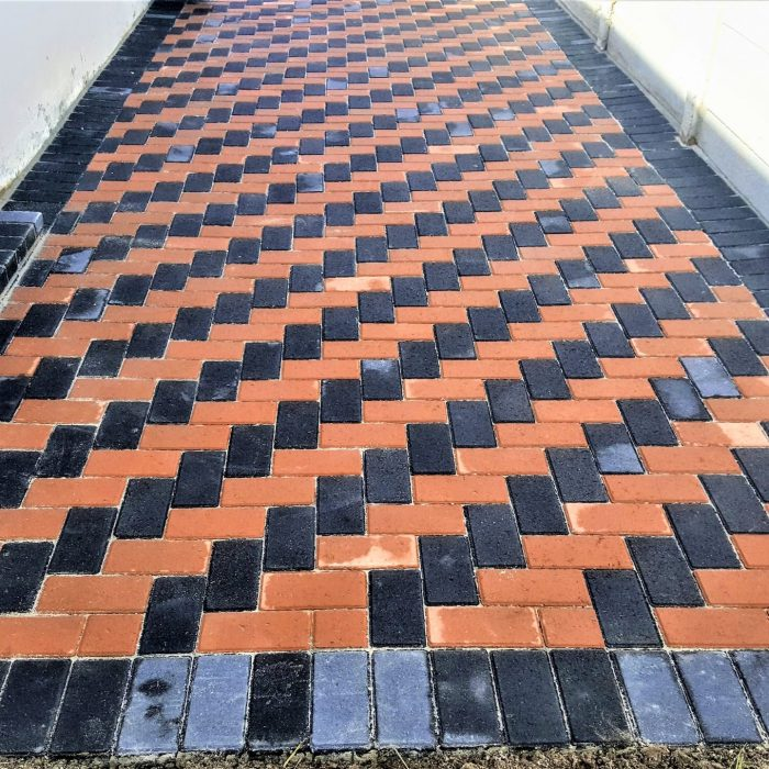 CEMENT BOND PAVERS WITH RED _ CHARCOAL PATTERN