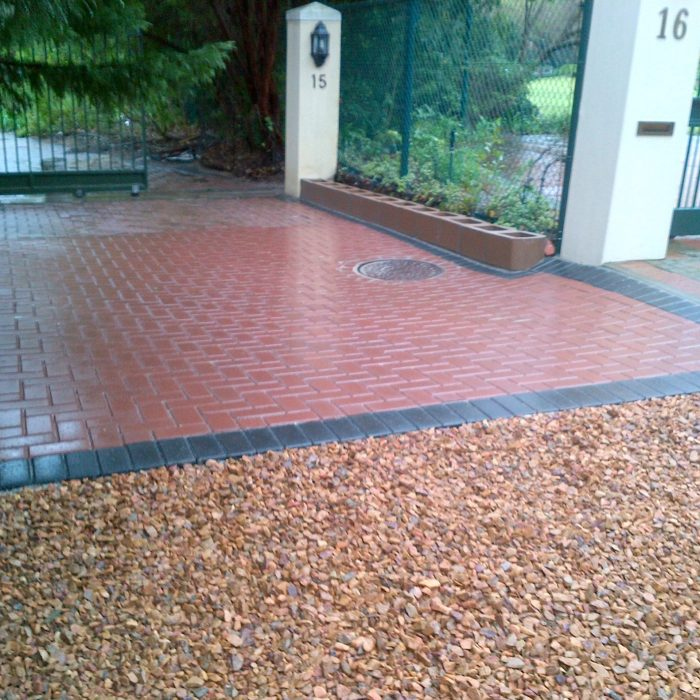 CEMENT BOND RED PAVERS WITH CHARCOAL BORDER _ TABLE MOUNTAIN STONE