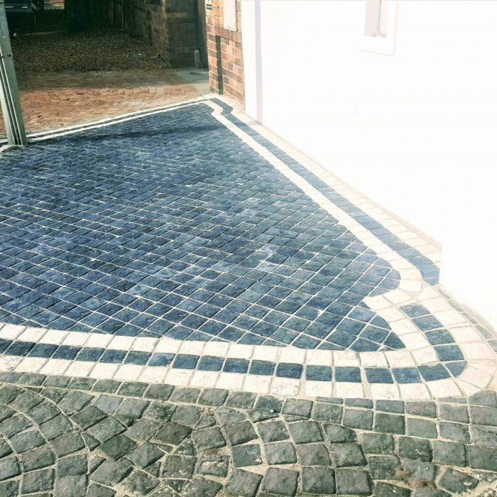 CHARCIAL CEMENT COBBLES WITH WHITE BORDER
