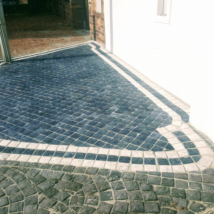 CHARCOAL COBBLES WITH WHITE DESIGN PATTERN