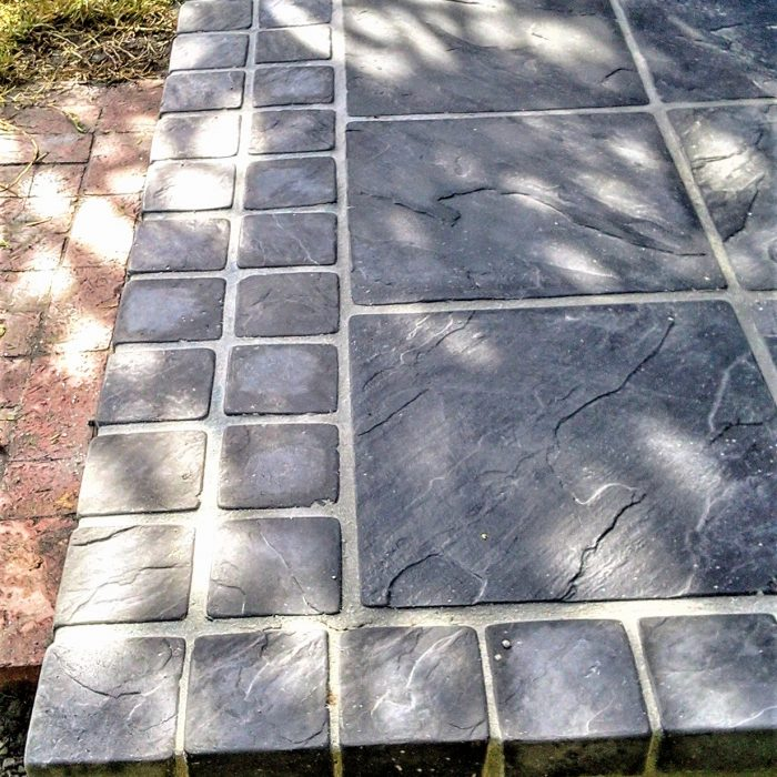 CHARCOAL SLABS WITH COBBLE BORDER