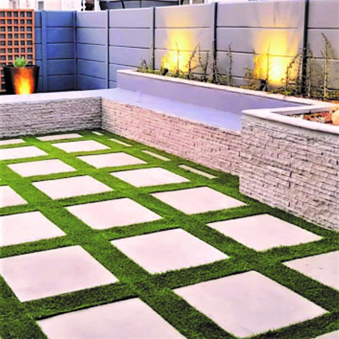 CLADDING WITH FLAGSTONE SLABS _ ARTIFICIAL GRASS INBETWEEN