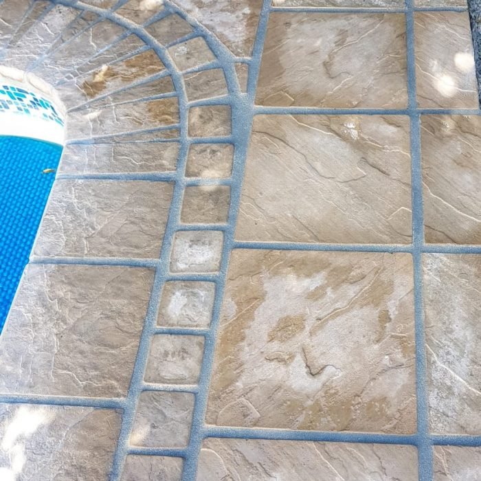 EARTH COLOURED SLABS WITH COBBLE INSERT _ BULLNOSE POOL COPING