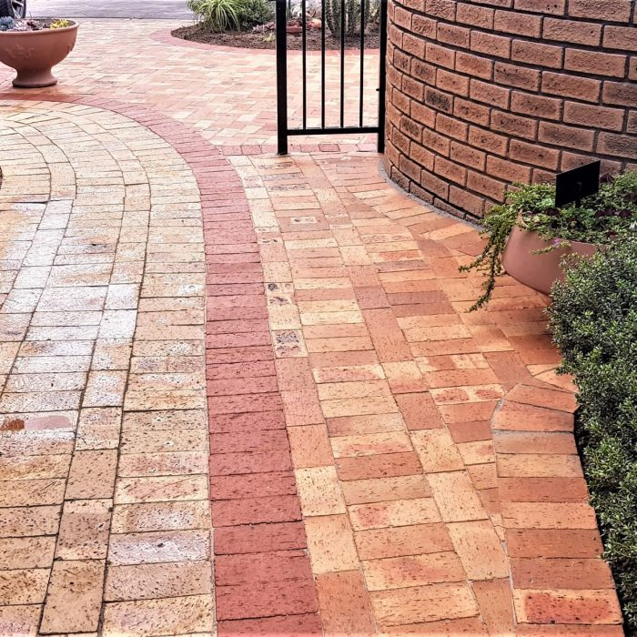 LANDSCAPING JOB WITH RED CLAY PAVER DEMARCATION LINE