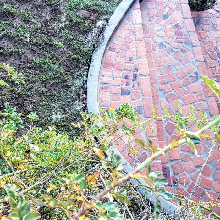 LANDSCAPING WITH RED HALF BRICK STEPS