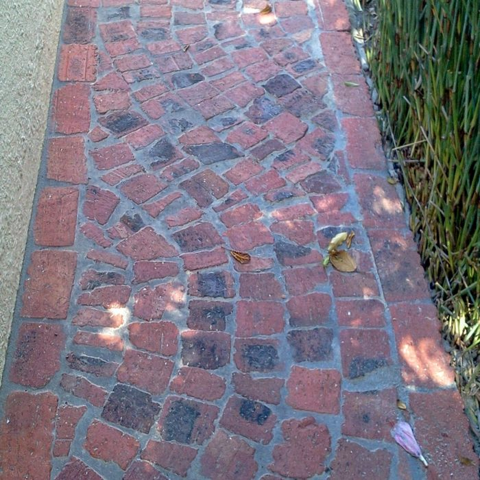 RED HALF BRICK PATHWAY IN SNAKE PATTERN