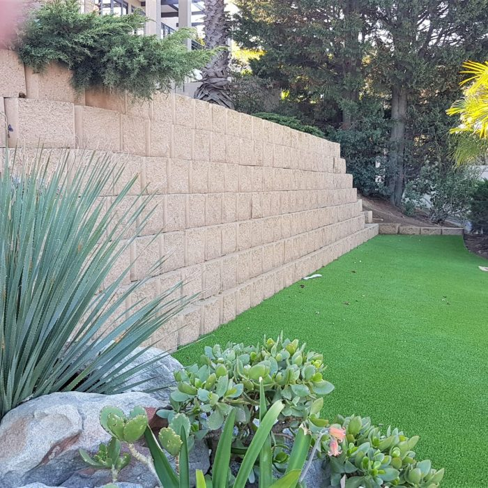 RETAINER BLOCKS AND ARTIFICAL LAWN