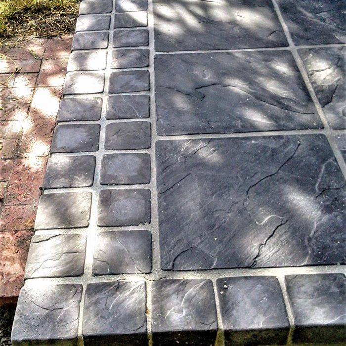 SLABS CHARCOAL WITH COBBLE BORDER