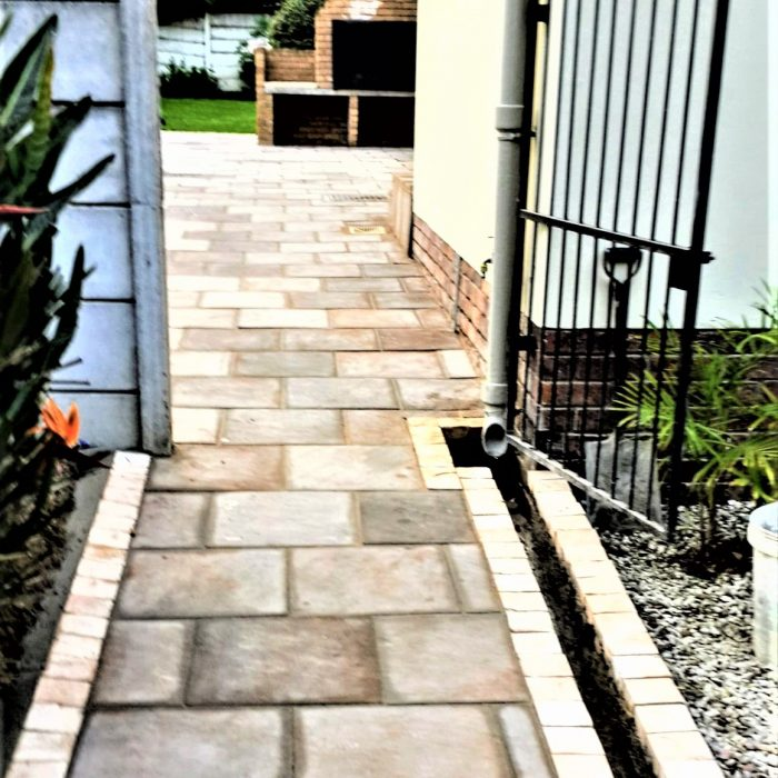 SLABS WITH COBBLE BORDER