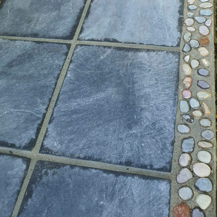 Slabs charcoal with jewel pebbles as border