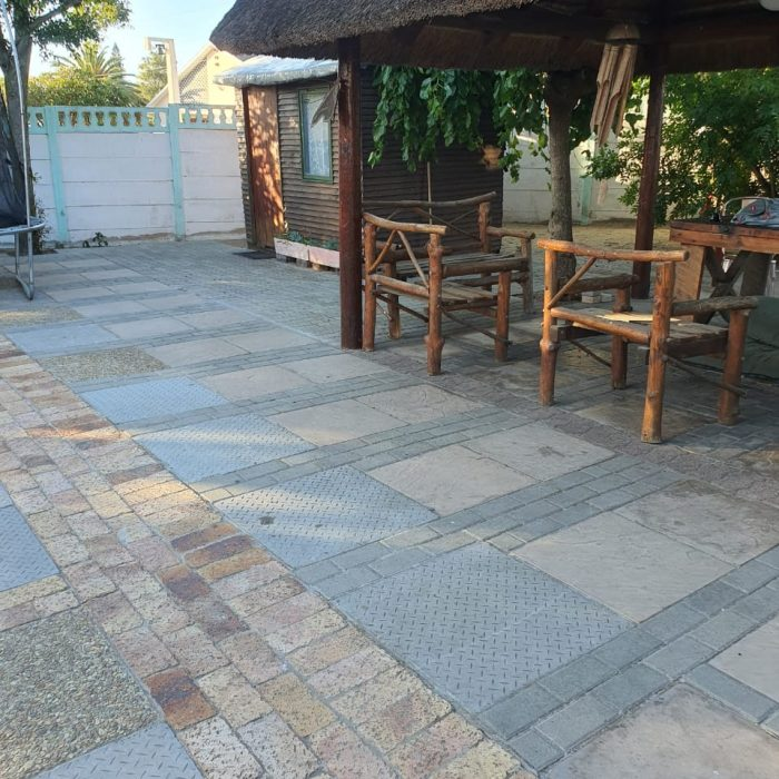 Concrete slab with variety of clay & cement pavers